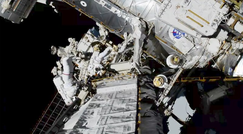 In this photo provided by NASA astronauts Christina Koch and Jessica Meir exits the International Space Station on Friday, Oct. 18, 2019.  The world's first female spacewalking team is making history high above Earth.  This is the first time in a half-century of spacewalking that a woman floated out without a male crewmate. Their job is to fix a broken part of the station's solar power network.(NASA via AP)