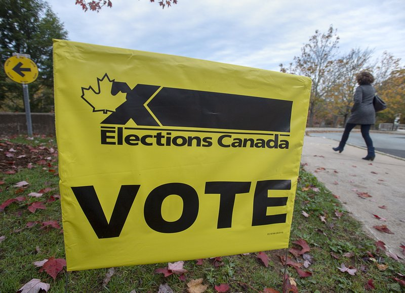A voter heads to cast their vote in Canada's federal election at the Fairbanks Interpretation Centre in Dartmouth, Nova Scotia, Monday, Oct. 21, 2019. (Andrew Vaughan/The Canadian Press via AP)