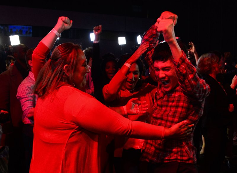 Liberal supporters react as poll numbers come in at Liberal election headquarters in Montreal on Monday Oct. 21, 2019. (Sean Kilpatrick/The Canadian Press via AP)