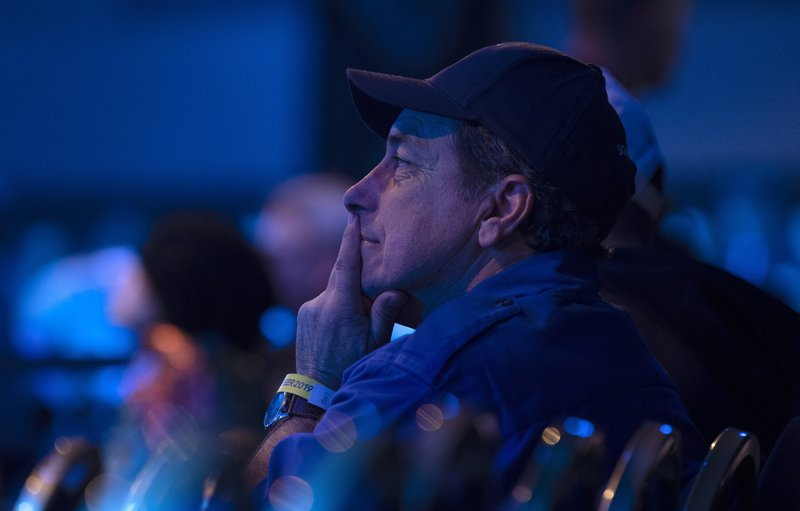 A supporter watches results at the Conservative headquarters in Regina, Saskatchewan, Monday, Oct. 21, 2019. (Adrian Wyld/The Canadian Press via AP)