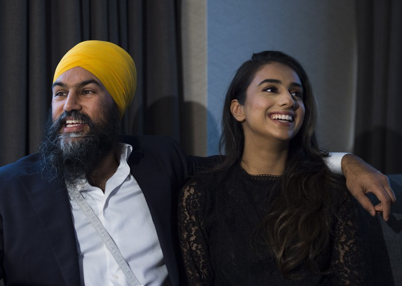 New Democratic Party leader Jagmeet Singh and his wife Gurkiran Kaur watch the Canadian election results come in at his hotel room in Burnaby, British Columbia, Monday, Oct. 21, 2019. (Nathan Denette/The Canadian Press via AP)