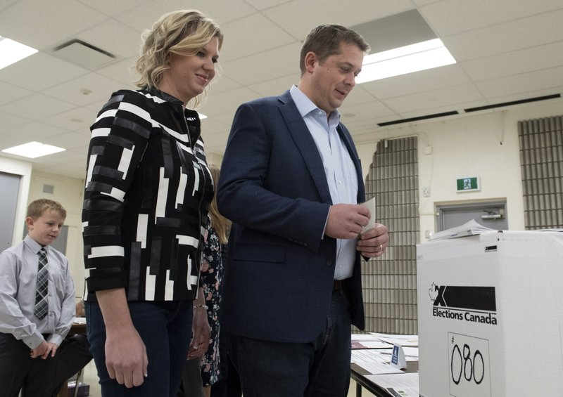 Conservative leader Andrew Scheer and his wife Jill Scheer wait to cast their ballots at a polling station in his riding in Regina, Saskatchewan, Monday, Oct. 21, 2019. (Adrian Wyld/The Canadian Press via AP)