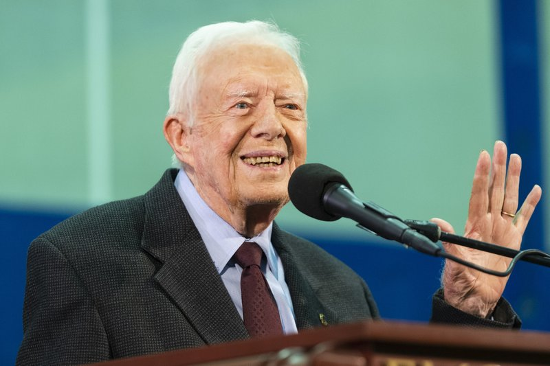 FILE - In this Sept. 18, 2019, file photo former President Jimmy Carter acknowledges a student who's question has been picked for him to answer during an annual Carter Town Hall held at Emory University in Atlanta. Carter has been hospitalized after a fall at his home in Plains, Ga. A statement from The Carter Center says Carter suffered