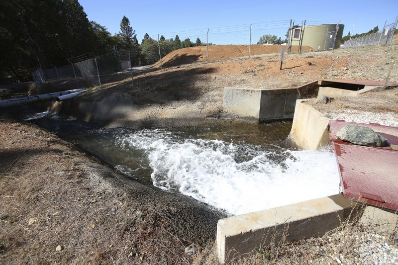 Treated Nevada Irrigation District water leaves a pumping plant off of Loma Rica Road in Grass Valley, Calif., Wednesday, Oct. 23, 2019, headed for Alta Sierra and Lake of the Pines residents. NID generators have provided seamless water delivery to customers amid the Pacific Gas & Electric Co. shutdown. The outages will last about 48 hours, the utility said ,but its seven-day forecast shows an elevated likelihood of a shut-off across a much larger portion of Northern California for the weekend, when heavy winds are expected to return. (Elias Funez/The Union via AP)