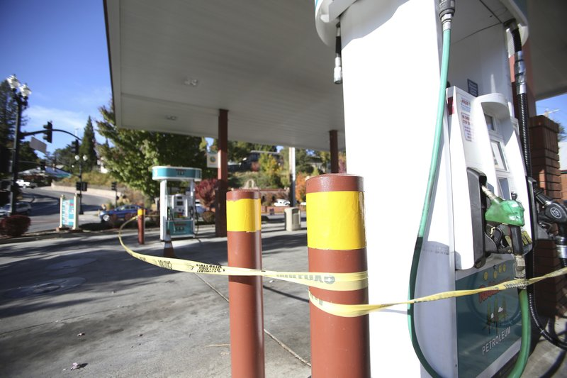 Robinson Enterprises Gas Station in downtown Grass Valley, Calif., sits vacated following the shut off of power Wednesday, Oct. 23, 2019. The Robinson gas station in Nevada City was one of the only stations to continue pumping gas following the shutdown two weeks ago. Lights went out across large portions of Northern California on Wednesday, as the state's largest utility began its second massive blackout in two weeks, citing the return of dangerous fire weather. (Elias Funez/The Union via AP)