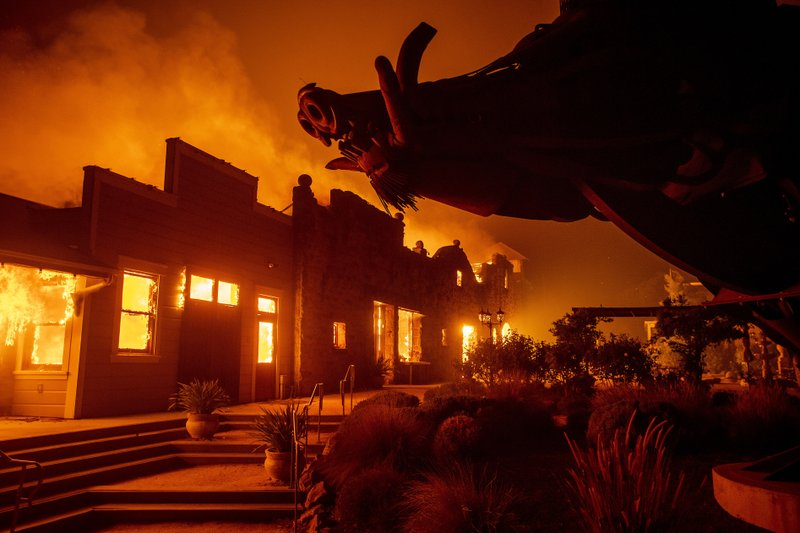 Flames from the Kincade Fire consume Soda Rock Winery on Sunday, Oct 27, 2019, in Healdsburg, Calif. (AP Photo/Noah Berger)