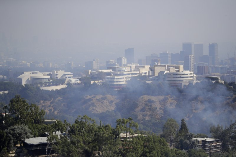 The Getty Center is covered in smoke as the Getty fire burns Monday, Oct. 28, 2019, in Los Angeles. (AP Photo/Marcio Jose Sanchez)