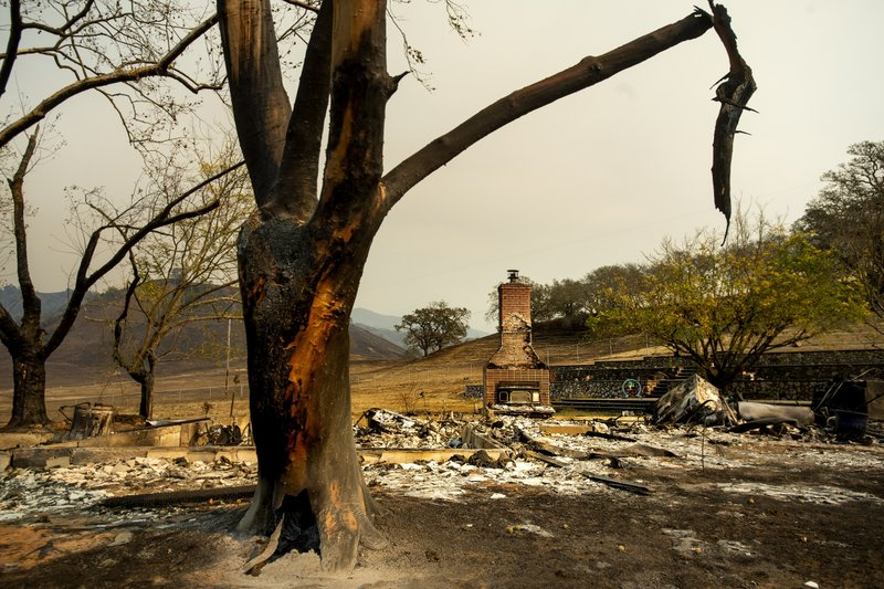 A chimney stands at a home leveled by the Kincade Fire in Calistoga, Calif., on Monday, Oct. 28, 2019. According to Cal Fire, the blaze has scored more than 66,000 acres and destroyed at least 96 structures. (AP Photo/Noah Berger)