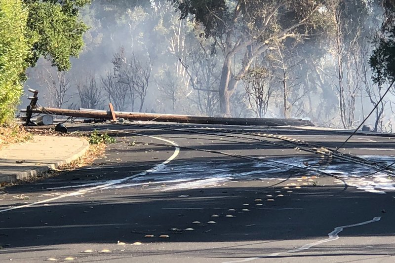 In this photo taken Sunday, Oct. 27, 2019, are power lines in Lafayette, Calif., that show damage near where a fire started. Pacific Gas & Electric Co. power lines may have started two wildfires over the weekend in the San Francisco Bay Area, the utility said Monday, even though widespread blackouts were in place to prevent downed lines from starting fires during dangerously windy weather. The fires described in PG&E reports to state regulators match blazes that destroyed a tennis club and forced evacuations in Lafayette, about 20 miles (32 kilometers) east of San Francisco. (Matthias Gafni/San Francisco Chronicle via AP)