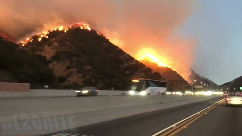 A fire erupted before dawn Monday in Los Angeles and roared up slopes into well-to-do neighborhoods, threatening thousands of homes and moving near the world-famous Getty art museum (Oct. 28)