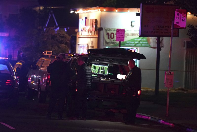 Police investigate the scene of a shooting on the E. 7th Street in Long Beach on Wednesday, Oct. 30, 2019. The shooting happened in a backyard of a home behind a nail salon. (Scott Varley/The Orange County Register via AP)