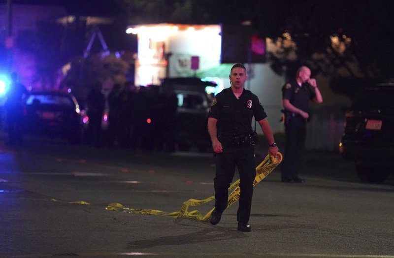 Police close off the scene of a shooting  on E. 7th Street in Long Beach on Wednesday, Oct. 30, 2019. The shooting happened in a backyard of a home behind a nail salon. (Scott Varley/The Orange County Register via AP)