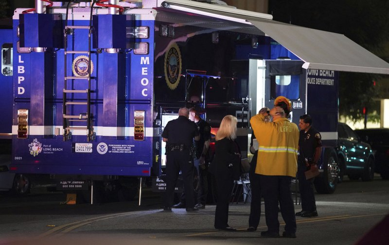 Police gather outside a mobile command post as they investigate the scene of a shooting in Long Beach on Wednesday, Oct. 30, 2019. Authorities say three people were fatally shot and nine others injured at a home in Long Beach, California.(Scott Varley/The Orange County Register via AP)/The Orange County Register via AP)