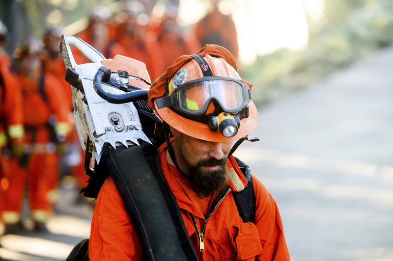 Inmate firefighters prepare to battle the Kincade Fire near Healdsburg, Calif., on Tuesday, Oct. 29, 2019. Millions of people have been without power for days as fire crews race to contain two major wind-whipped blazes that have destroyed dozens of homes at both ends of the state: in Sonoma County wine country and in the hills of Los Angeles. (AP Photo/Noah Berger)