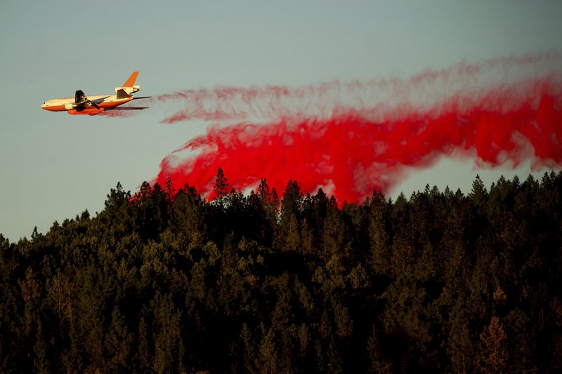 An air tanker drops retardant while battling the Kincade Fire near Healdsburg, Calif., on Tuesday, Oct. 29, 2019. The overall weather picture in northern areas is improving as powerful, dry winds bring extreme fire weather to Southern California. (AP Photo/Noah Berger)