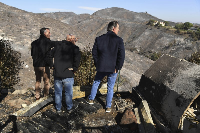 From left, L.A. Mayor Eric Garcetti, L.A. City Councilman Mike Bonin and California Governor Gavin Newsom view a burned home along Tigertail Road in Brentwood, Calif., Tuesday Oct. 29, 2019. (Wally Skalij/Los Angeles Times via AP, Pool)