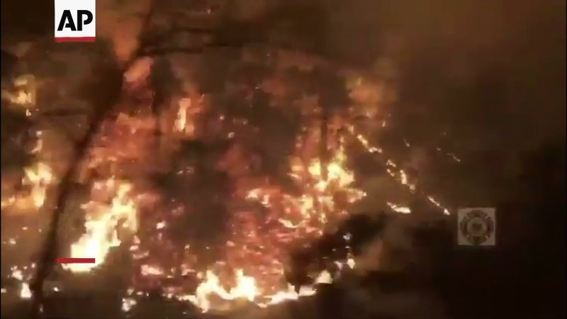 Fire crews continue to battle a blaze in Sonoma County, California, as forecasters call for a return of high winds to the region. (Oct. 29)