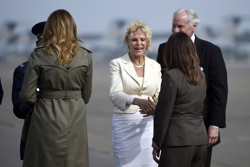 South Carolina Gov. Henry McMaster and his wife, Peggy, greet first lady Melania Trump and Karen Pence, wife of Vice President Mike Pence, Wednesday, Oct. 30, 2019, at Joint Base Charleston, S.C. (AP Photo/Meg Kinnard)