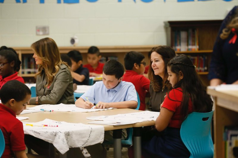 First lady Melania Trump, left, and Karen Pence, right, visit students at Lambs Elementary in North Charleston, S.C. on Wednesday, Oct. 30, 2019. (Grace Beahm Alford/The Post And Courier via AP, Pool)