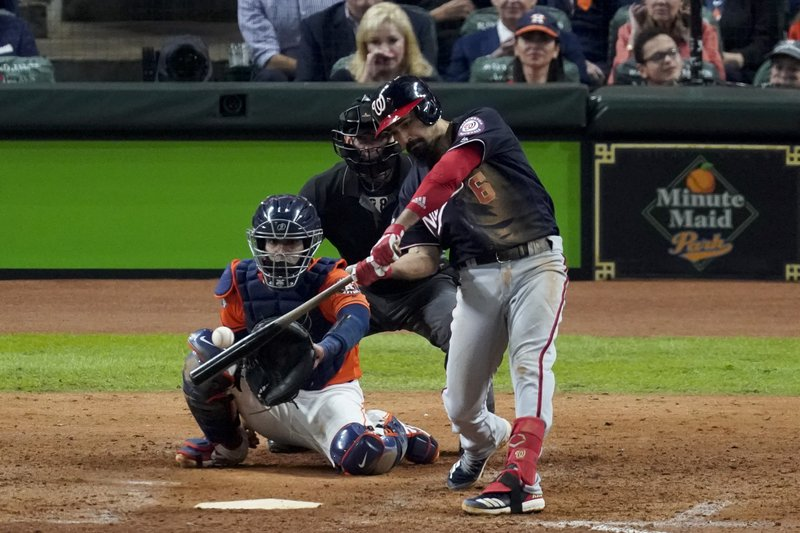 Washington Nationals' Anthony Rendon hits a home run against the Houston Astros during the seventh inning of Game 7 of the baseball World Series Wednesday, Oct. 30, 2019, in Houston. (AP Photo/Eric Gay)