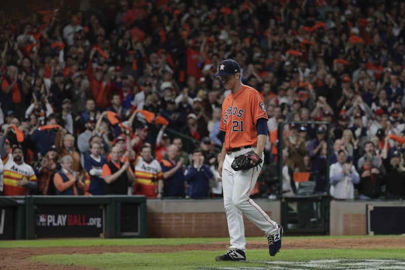 Fans cheer as Houston Astros starting pitcher Zack Greinke leaves the game during the seventh inning of Game 7 of the baseball World Series against the Washington Nationals Wednesday, Oct. 30, 2019, in Houston. (AP Photo/David J. Phillip)