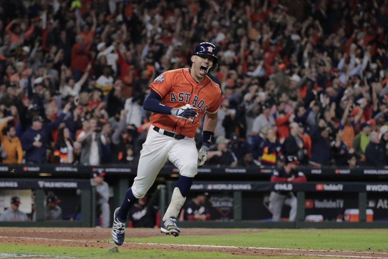 Houston Astros' Carlos Correa reacts to his RBI single during the fifth inning of Game 7 of the baseball World Series against the Washington Nationals Wednesday, Oct. 30, 2019, in Houston. (AP Photo/David J. Phillip)