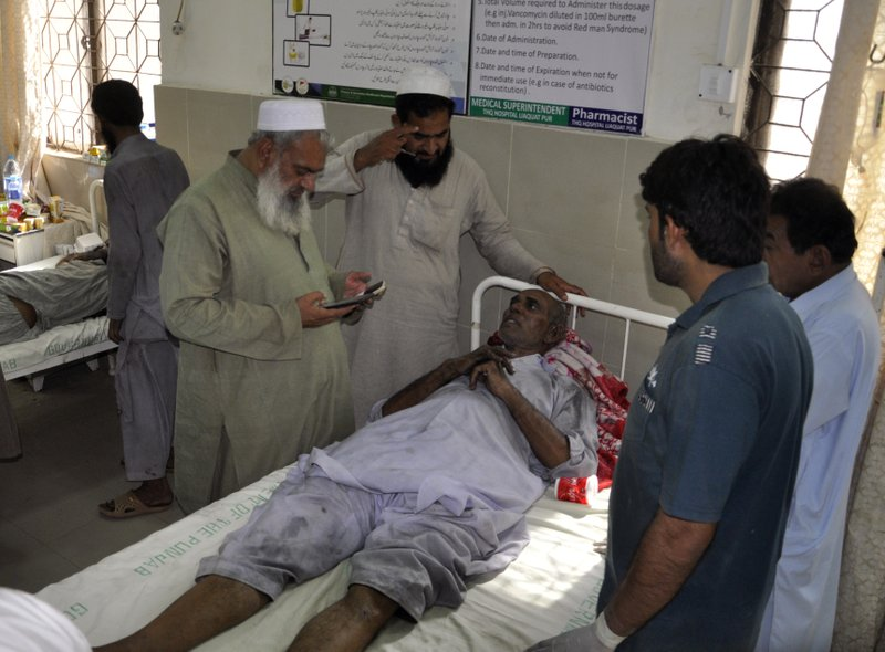 People visit victims of a train fire, at a local hospital in Liaquatpur, Pakistan, Thursday, Oct. 31, 2019. A massive fire engulfed three carriages of the train traveling in the country's eastern Punjab province (AP Photo/Siddique Baluch)
