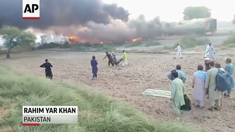 A massive fire caused by a cooking gas stove erupted Thursday on a train traveling in Pakistan's eastern Punjab province, killing dozens of passengers, officials said. (Oct. 31)