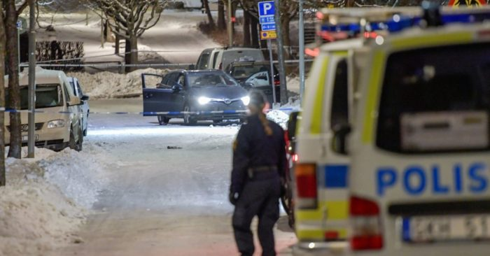 A policeman stands guard near a checkpoint in Stockholm, Sweden, on March 8, 2017. (Jessica Gow/TT News Agency via AP)