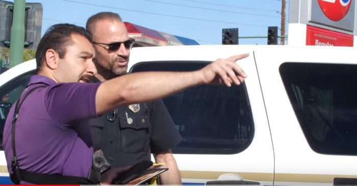 Elvis Kesto points to a Phonenix police officer the place where the abortion doctor who threatened him with a firearm is. (Screenshot YouTube-Apologia Studios).