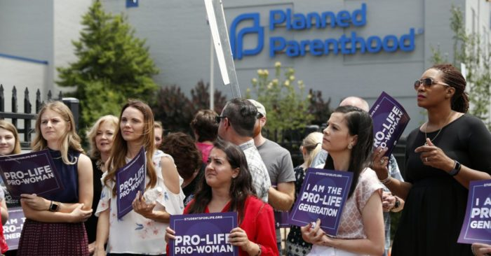 In this June 4, 2019 photo, pro-life advocates gather in front of a Planned Parenthood clinic. (Photo AP/Jeff Roberson)