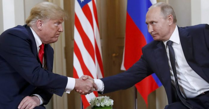 U.S. President Donald Trump, left, and Russian President Vladimir Putin shake hands at the beginning of a meeting at the Presidential Palace in Helsinki, Finland on July 16, 2018. (AP / Pablo Martinez Monsivais, File)