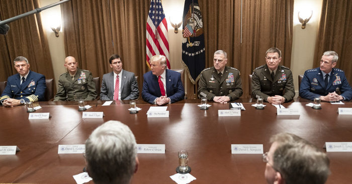 President Donald J. Trump, accompanied by Joint Chiefs of Staff General Mark A. Milley, attends a briefing with senior military officials on Monday, October 7, 2019, in the White House Cabinet Room. (Official White House Photo by Shealah Craighead)