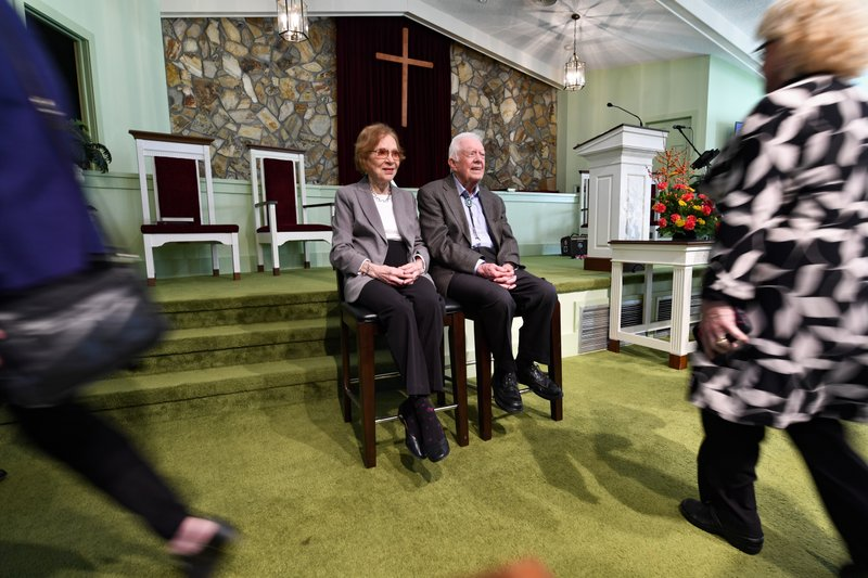 Former U.S. President Jimmy Carter and former first lady Rosalynn Carter, left, sit as guests of Maranatha Baptist Church come  to have their photo made with them, after Jimmy taught Sunday school there, Sunday, Nov. 3, 2019, in Plains, Ga. (AP Photo/John Amis)