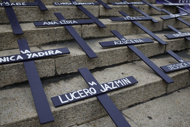 Crosses lie on the steps of the Angel of Independence Monument in memory of women who have been murdered or disappeared, as part of a protest to demand justice  one day after the Day of the Dead holiday in Mexico City, Sunday, Nov. 3, 2019. Nine women are killed per day in Mexico, according to the U.N. (AP Photo/Ginnette Riquelme)