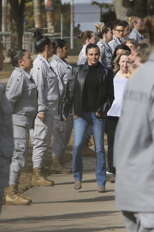 Inmates being released from the Eddie Warrior Correctional Center walk through a line of inmates that are a part of the Regimented Treatment Program at the prison, Monday, Nov. 4, 2019 in Taft, Okla. More than 450 inmates walked out the doors of prisons across Oklahoma on Monday as part of what state officials say is the largest single-day mass commutation in U.S. history. (AP Photo/Sue Ogrocki)