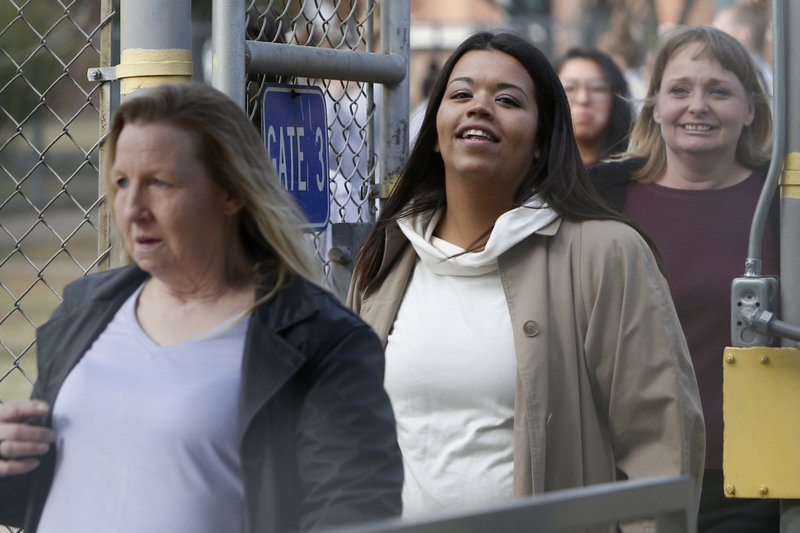Inmates being released from the Eddie Warrior Correctional Center walk through the gate at the prison, Monday, Nov. 4, 2019 in Taft, Okla. More than 450 inmates walked out the doors of prisons across Oklahoma on Monday as part of what state officials say is the largest single-day mass commutation in U.S. history. (AP Photo/Sue Ogrocki)