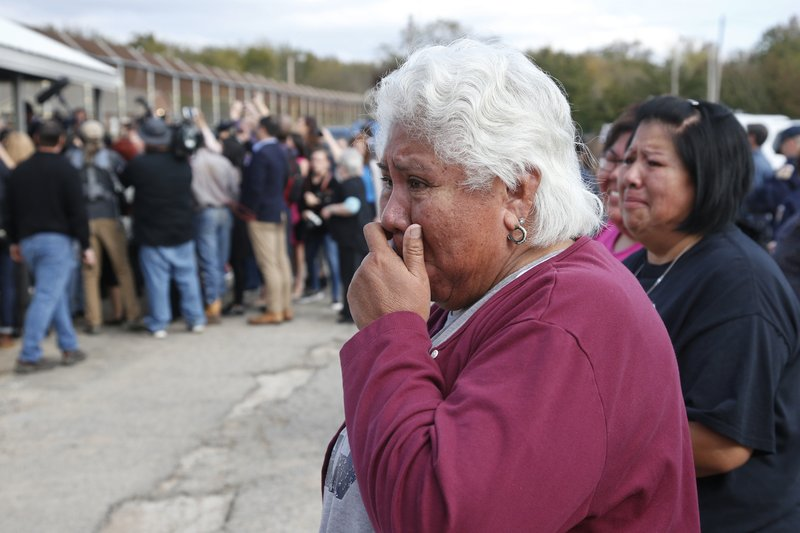 Sally Taylor, left, and Sarah Taylor, right, wait for their granddaughter and niece, Tess Harjo, to walk out of Eddie Warrior Correctional Center Monday, Nov. 4, 2019 in Taft, Okla. More than 450 inmates walked out the doors of prisons across Oklahoma on Monday as part of what state officials say is the largest single-day mass commutation in U.S. history. (AP Photo/Sue Ogrocki)