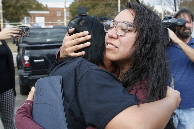 Tess Harjo, right, embraces her aunt Sarah Taylor, left, after being released from Eddie Warrior Correctional Center Monday, Nov. 4, 2019 in Taft, Okla. More than 450 inmates walked out the doors of prisons across Oklahoma on Monday as part of what state officials say is the largest single-day mass commutation in U.S. history. (AP Photo/Sue Ogrocki)