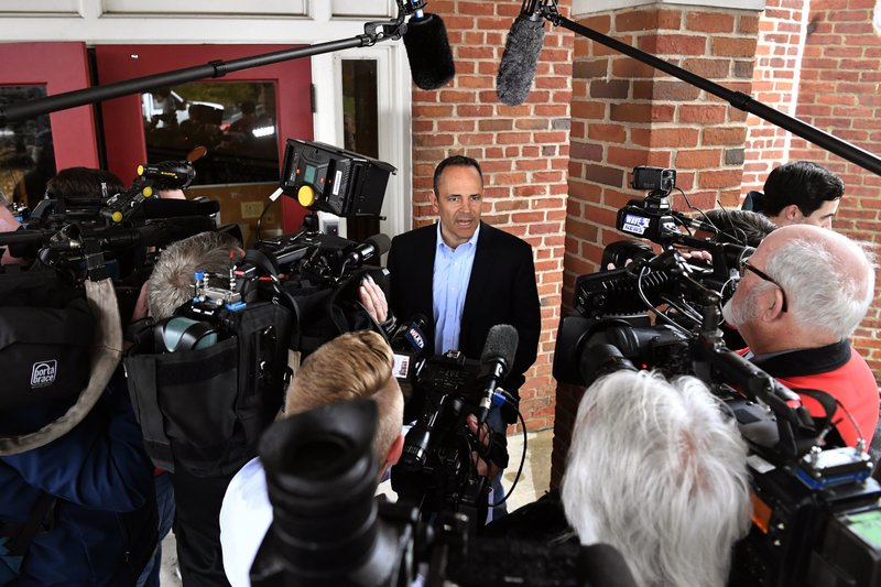 Kentucky Governor and Republican gubernatorial candidate Matt Bevin speaks with reporters after casting his ballot in the state's general elections in Louisville, Ky., Tuesday, Nov. 5, 2019. (AP Photo/Timothy D. Easley)