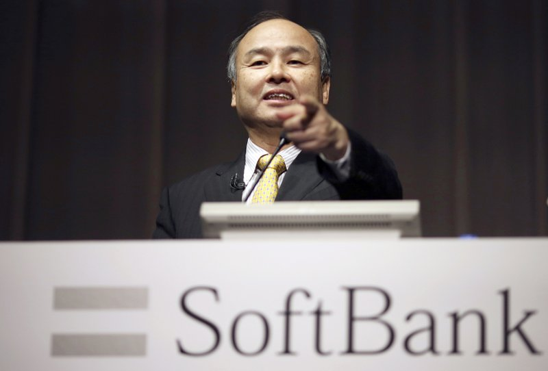 FILE - In this Nov. 4, 2014, file photo, SoftBank founder and Chief Executive Officer Masayoshi Son speaks during a news conference in Tokyo. Japanese technology company SoftBank Group Corp. said Wednesday, Nov. 6, 2019, it has tumbled into losses for the second quarter over money-losing investments, including a bailout for office-space sharing startup WeWork.(AP Photo/Eugene Hoshiko, File)