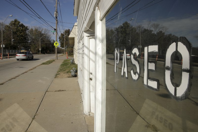 In this Sunday, Nov. 3, 2019, photo, a car passes a business on Dr. Martin Luther King Jr. Blvd. in Kansas City, Mo. In January, the City Council voted to rename one of the city's main boulevards, The Paseo, after King, but many in the community want the old name back. A petition drive put the issue on the Nov. 5 ballot pitting neighbors against each other. (AP Photo/Charlie Riedel)