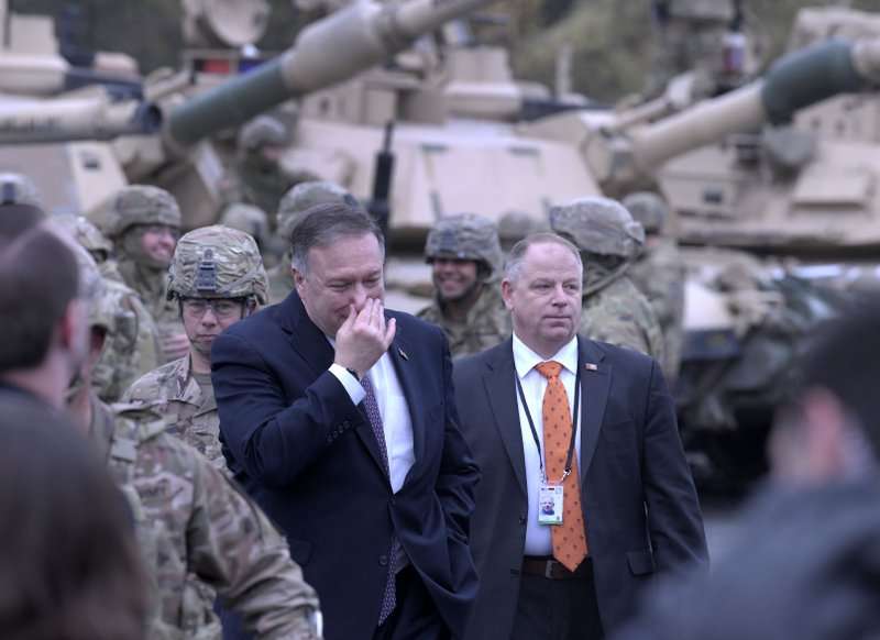 U.S. Secretary of State Mike Pompeo talks to US soldiers based in Grafenwoehr, Germany, Thursday, Nov. 7, 2019. (AP Photo/Jens Meyer)