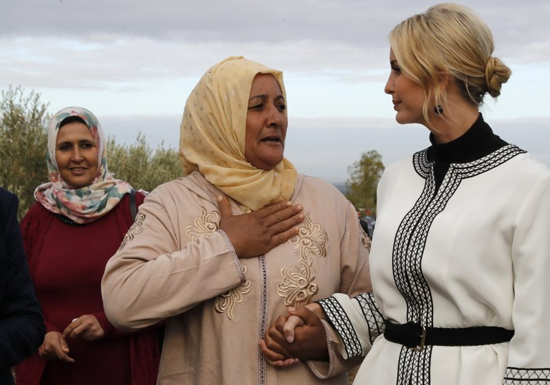 Farmer Aicha Bourkib talks to Ivanka Trump's hand, the daughter and senior adviser to President Donald Trump, in the province of Sidi Kacem, Morocco, Thursday, Nov. 7, 2019, as Ivanka Trump tours an olive grove collective where local women farmers are benefitting from changes allowing them to inherit land. (AP Photo/Jacquelyn Martin)