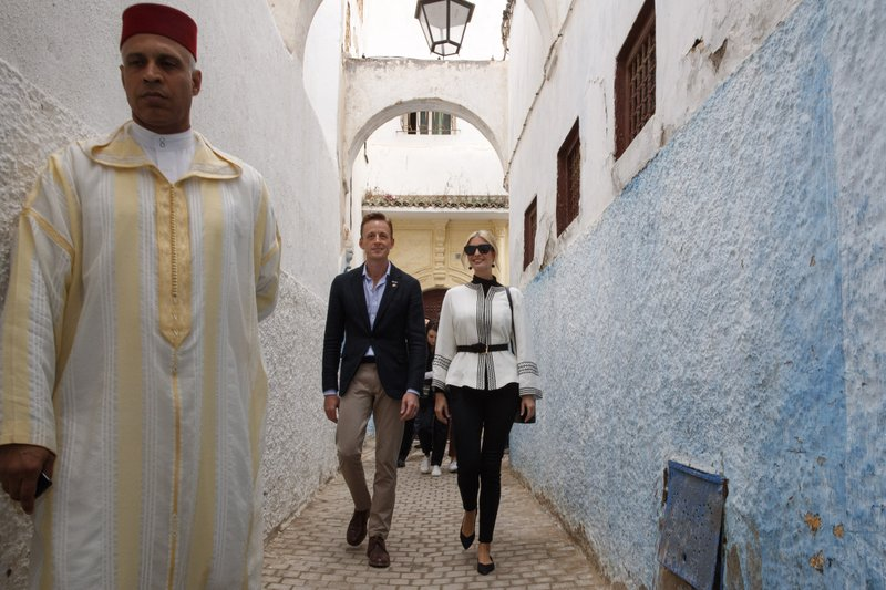 Ivanka Trump, right, the daughter and senior adviser to President Donald Trump, walks with Sean Cairncross, CEO of the Millennium Challenge Corporation, through a medina, Thursday, Nov. 7, 2019, in Rabat, Morocco, after attending a tea ceremony and roundtable event. (AP Photo/Jacquelyn Martin)