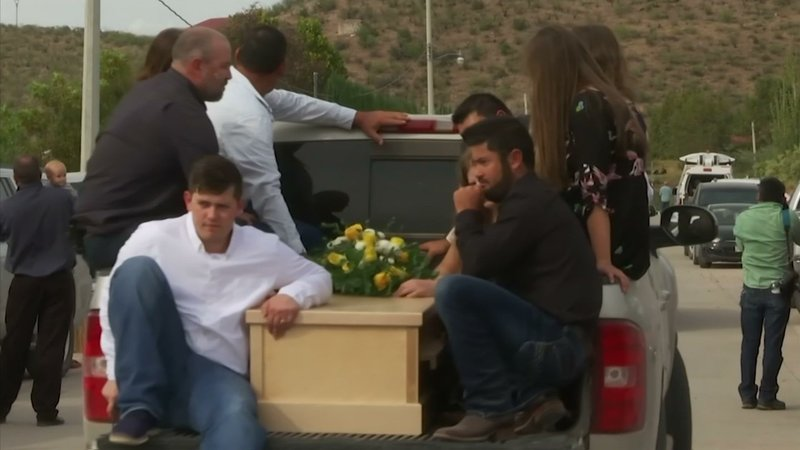 A mother and two sons were laid to rest in hand-hewn pine coffins in a single grave dug out of the rocky soil on Thursday at the first funeral in Mexico for the victims of a drug cartel ambush that left nine American women and children dead. (Nov 7)