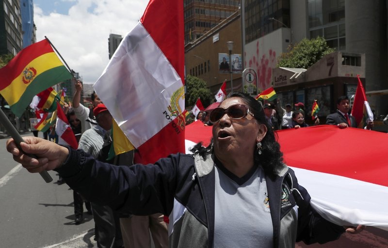 Anti-government protesters march against the reelection of President Evo Morales in La Paz, Bolivia, Sunday, Nov. 10, 2019. President Morales is calling for new presidential elections and an overhaul of the electoral system Sunday after a preliminary report by the Organization of American States found irregularities in the Oct. 20 elections. (AP Photo/Juan Karita)