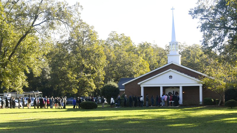 In this Sunday, Nov. 3, 2019, photo, a crowd waits in line to attend Sunday school being taught by former President Jimmy Carter at Maranatha Baptist Church, in Plains, Ga. Carter can still draw a crowd, and he does each time he teaches Sunday school in his hometown of Plains. (AP Photo/John Amis)