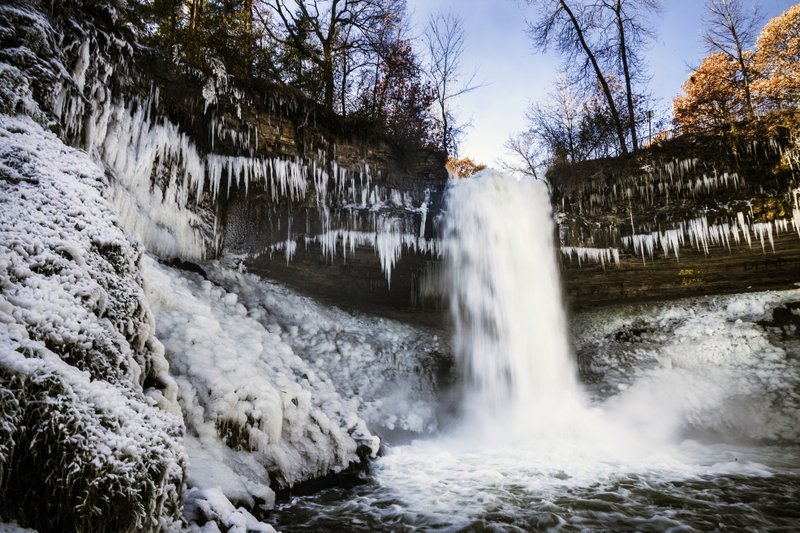 Minnehaha Falls' icy spray coats its sides with ice and snow due to low temperatures in Minneapolis, Monday, Nov. 11, 2019. (Richard Tsong-Taatarii/Star Tribune via AP)