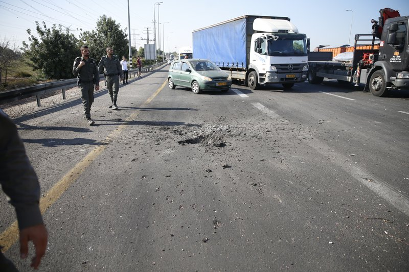 Israeli police block the road moments after a rocket fired by Palestinians militants from Gaza hit a main free way between Ashdod and Tel Aviv near Ashdod Israel, Tuesday, Nov. 12, 2019. Israel has killed a senior Islamic Jihad commander in Gaza in a rare targeted killing that threatened to unleash a fierce round of cross-border violence with Palestinian militants. (AP Photo/Ariel Schalit)